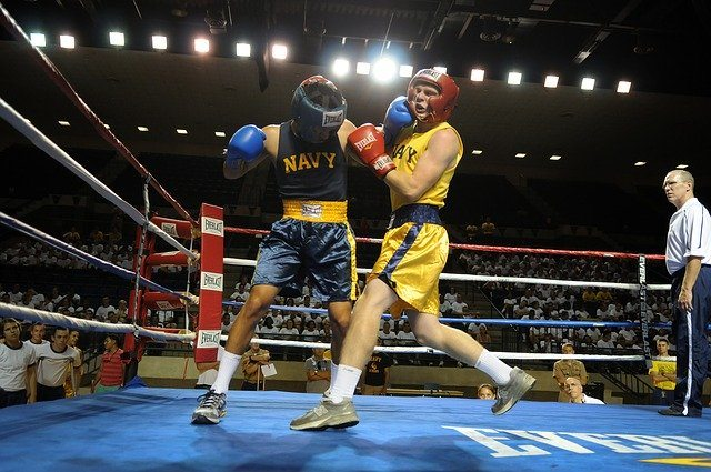 boxers in a ring trade blows to the head, which can contribute to a risk of CTE